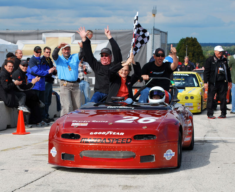 Jesse Prather takes Ron Davis' MGB for a victory lap!